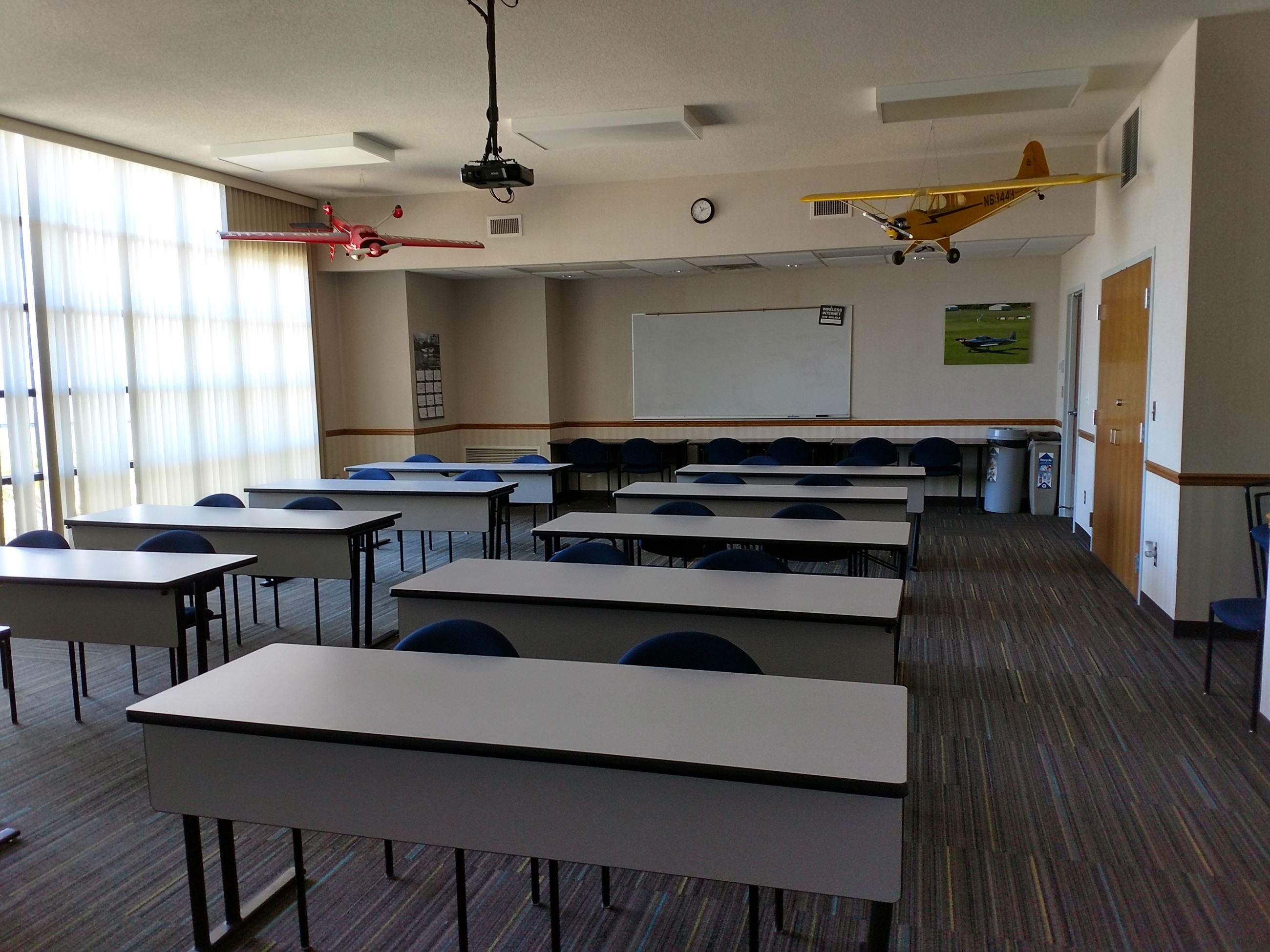 Viewing the front of the classroom, showing the podium and the screen